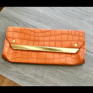 NWOT orange credible patterned clutch